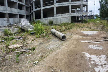 Near the abandoned unfinished building of the car Park is building debris 写真素材