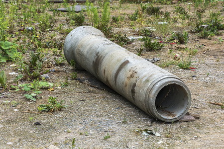 On the ground is a large diameter pipe for underground utilities
