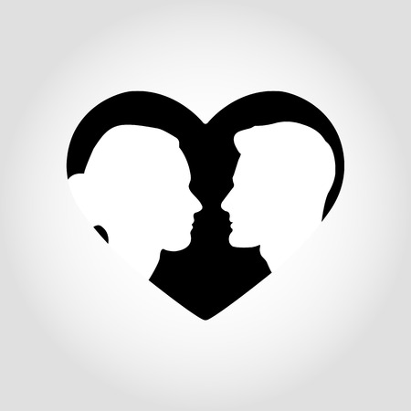 Silhouettes of male and female faces look at each other in the contour of the heart