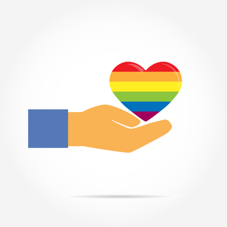 Hand supports the silhouette of a heart in the colors of LGBT, flat design