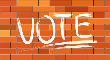 Political concept. The word VOTE is written with a brush of white paint on a brick wall.