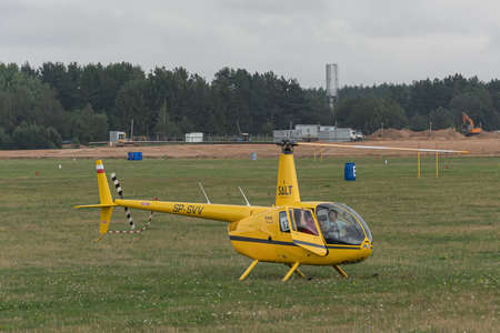 Minsk, Belarus - 07/25/2018: Helicopter on the green lawn of the airfield. Stock photo.
