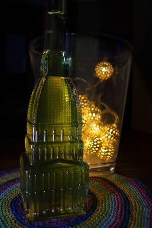 Italy, december 2019: beautiful bottle of absinthe with the shape of the Mole Antonelliana, a symbol of Turin, Italy.