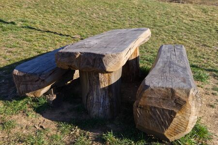 benches and table made from a single wooden trunk in a cottage