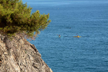 Five Lands, Italy - two canoeing tourists off the coast of Moneglia 写真素材 - 152299402