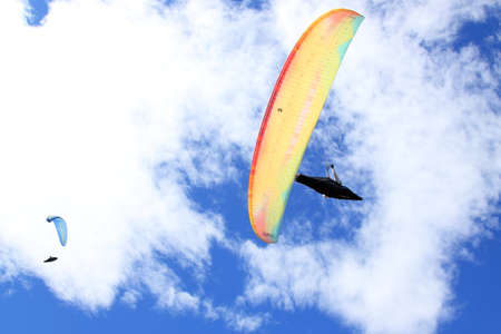 Belice, Italy - summer 2020: Italian paragliding championship, a competitor on the fly