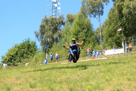 Belice, Italy - summer 2020: Italian paragliding championship, a competitor takes the chase for take-off