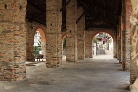 restored brick colonnade to house the city market, italian middleage style