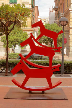 LaSpezia, Five Lands, Italy - summer 2020: red rocking horse sculpture in a city park 新闻类图片
