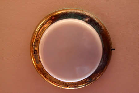 brass-framed wall planon of a sailboat