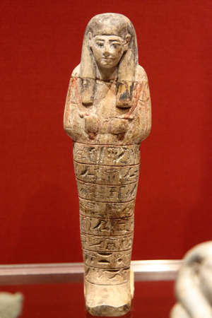 Archeological museum of LaSpezia, Italy - summer 2020: Egyptian wooden statue of ATUM RA, 1300 BC. Manfredi Collection.