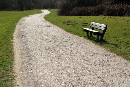 footpath: Footpath with bench in park