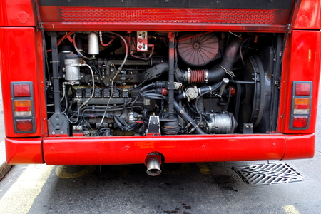 engine bonnet: Red bus with open engine