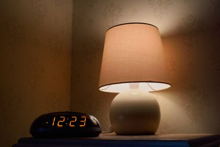bedside: Bedside table with lamp and clock