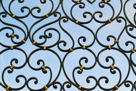 ironwork: Detail of beautiful ironwork gate painted in black Stock Photo