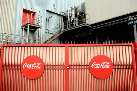 Gate at Coca-Cola bottling plant in Enfield, London is one of the largest bottling plants in the UK and is capable of filling a staggering six million bottles a day.