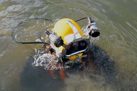 protective suit: Man wearing yellow environmental protective diving suit