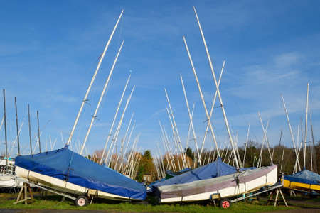 stored: Large group of sailing boats stored on trailers