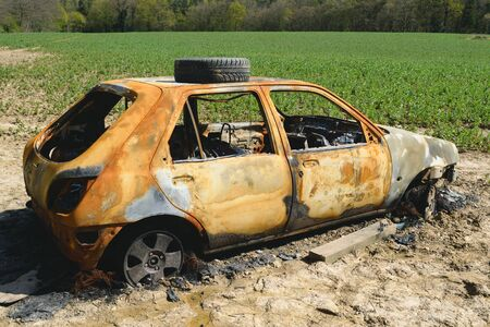 stolen: Stolen and burnt car in agricultural field