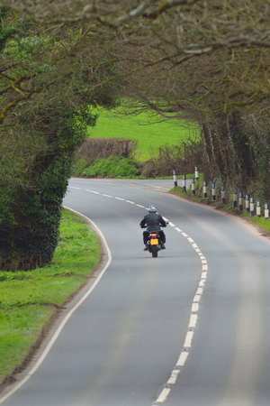 Motorbike on the road in Devon, England Stock Photo