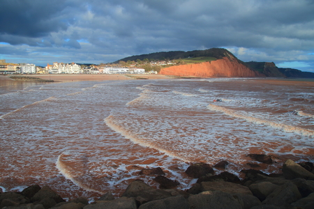 Waves on the sandy beach in Sidmouth, Devon Stock Photo