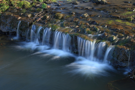Small waterfall in East Devon Area of Outsanding Natural Beauty Stock Photo