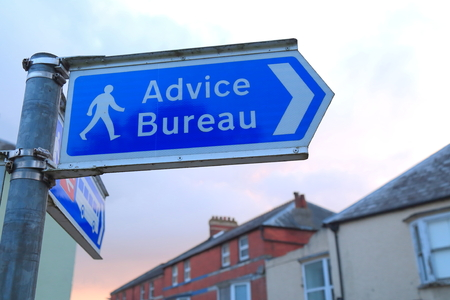 Advice Bureau sign on the street of Axminster in Devon