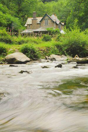 Watersmeet House and Easr Lyn River in Exmoor Nationl Park, Devon Stock fotó - 150294511