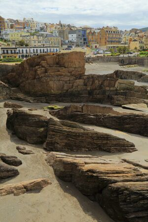 Rocks on the beach during low tide in seaside town of Ilfracombe on the North Devon coast