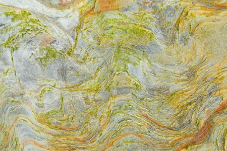 Detail of colorful sandstone surface as abstract background