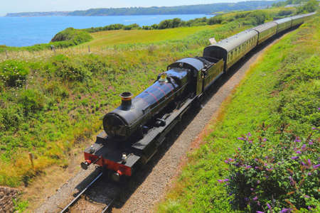 Train with vintage locomotive on the South Devon coast, UK