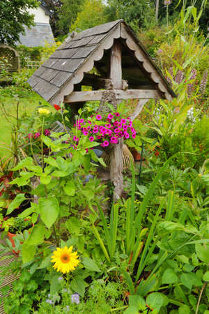 Wishing well in beautiful cottage style garden