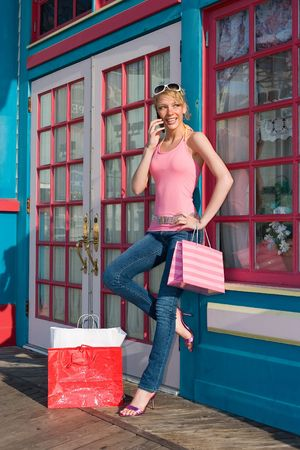 sidewalk talk: A young beautiful woman on a shopping spree