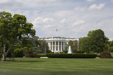 The white house with beautiful landscaping photo