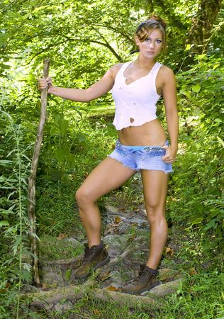 A beautiful young girl with walking stick photo