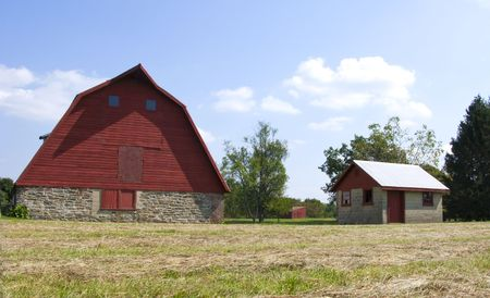 A traditional red barn and small shed photo