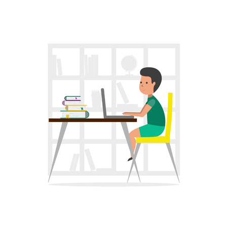 Small boy at home using a laptop computer.  Online Education concept.