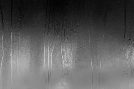 Glass with Condensate, Window with Steam and Water as Background or Texture