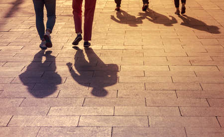 Shadows and Silhouettes of People, City during Sunset, People walking on a Street.
