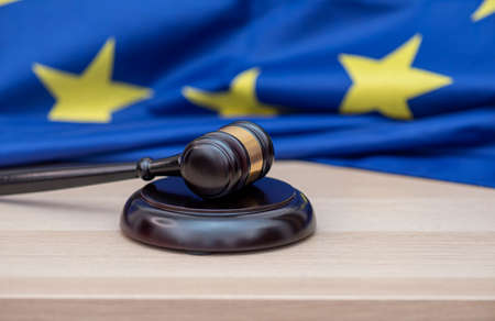 Flag of European Union and judges wooden gavel on the top, concept picture about court and justice