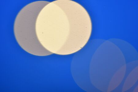 blurred circles on blue background
