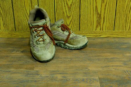 old used shoes for safety are on the wooden floor