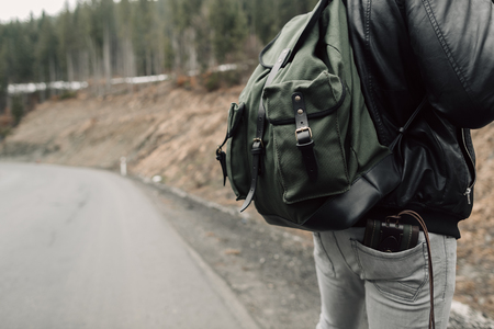 The man in the woods. Male with a black backpack. Forest