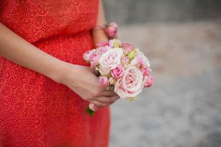 A bridesmaid holding her bouquet  photo