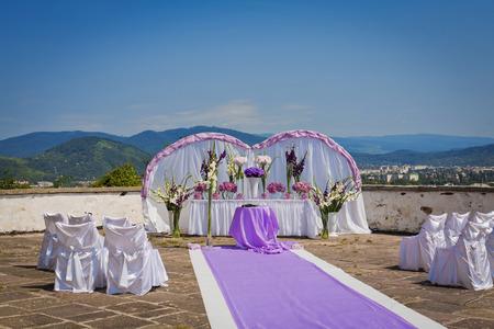 Wedding place in mountains, on a veranda of an old castle. Carpathians, Ukraine. photo