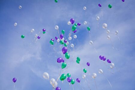 moving images: Multscolored balloons flying in sky at the wedding useful as texture or background.
