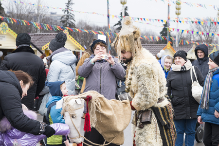 stature: MOSCOW, RUSSIA - MARCH 12, 2016: the man dressed in skins of animals on March 12,2016 in EXHIBITION of ACHIEVEMENTS of the NATIONAL ECONOMY, celebration of week of pancake (Maslenitsa), Moscow, Russia Editorial