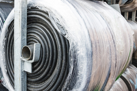 tar felt: the cable intended for construction is stored in a roll on open storage close-up Stock Photo