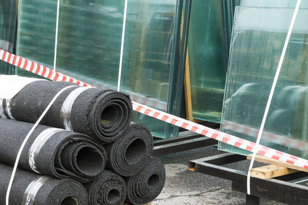 tar felt: the roofing felt and glass intended for construction are stored on open storage Stock Photo