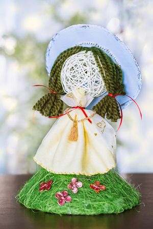 spring handmade doll on background